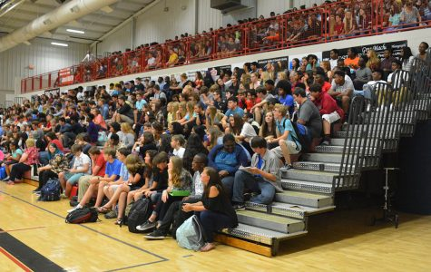 Principal holds class meetings during first week