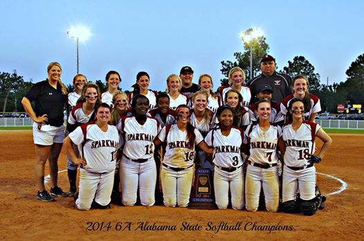 The softball team poses with their new trophy after defeating Hillcrest of Tuscaloosa.