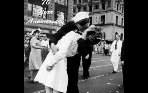 """Shown above is the famous """"coming home kiss"""" in New Yorks' Time Square on V-E day. The famous scene is shown from a different angle, as captured by a Naval photographer. Showing  photo instead of the LIFE one is used here for copyright reasons. Photo via Lt. Victor Jorgensen / The National Archives"""