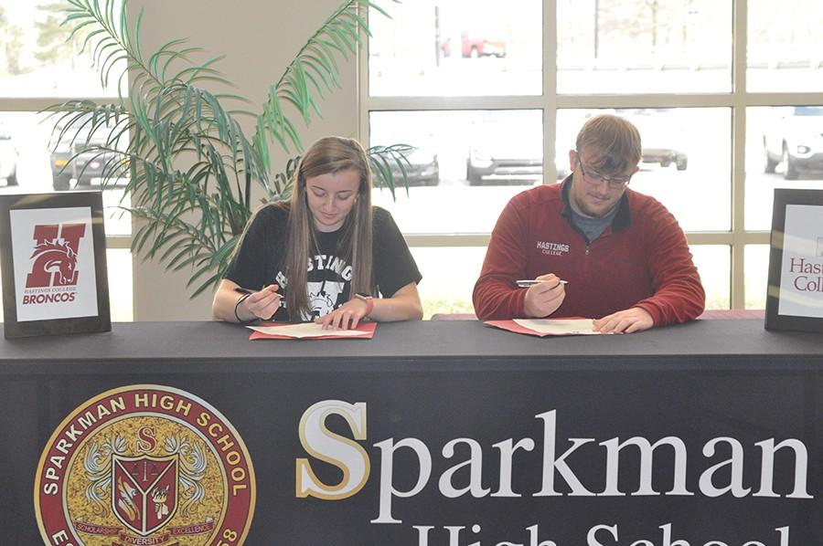 By signing their official bowling scholarships, Beth and Doug Fowler become the first Sparkman students to bowl in college.