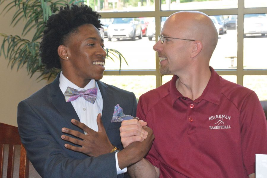 Senior Brandon Miller teaches coach Jamie Coggins how to dab. Miller will play basketball at Edward Waters College in the fall.