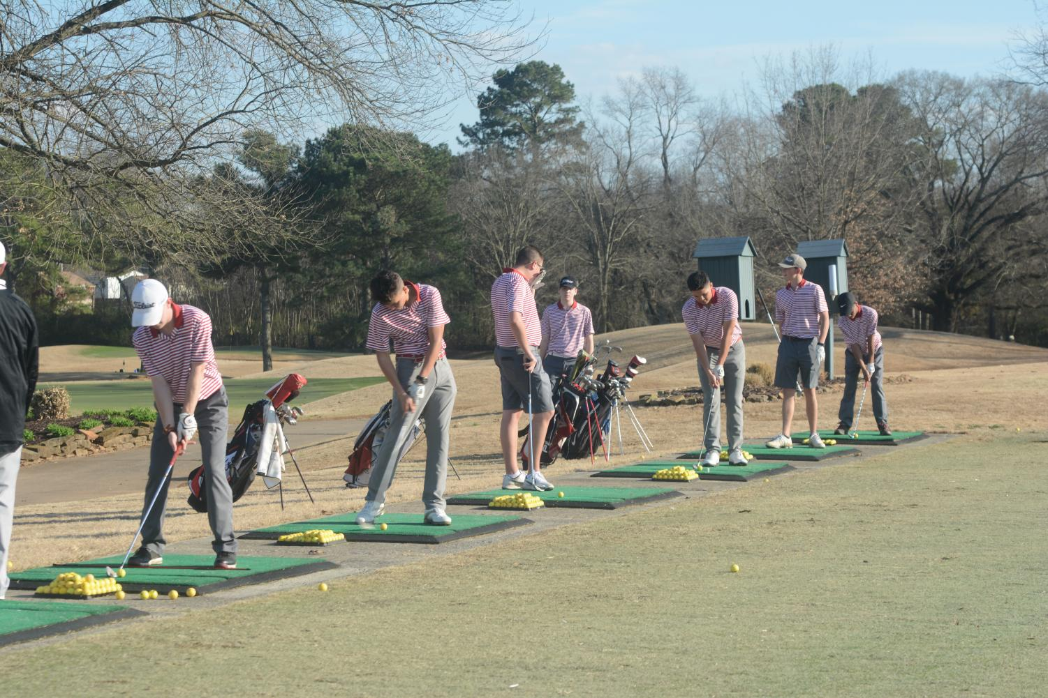 The golf team practices for the upcoming season.