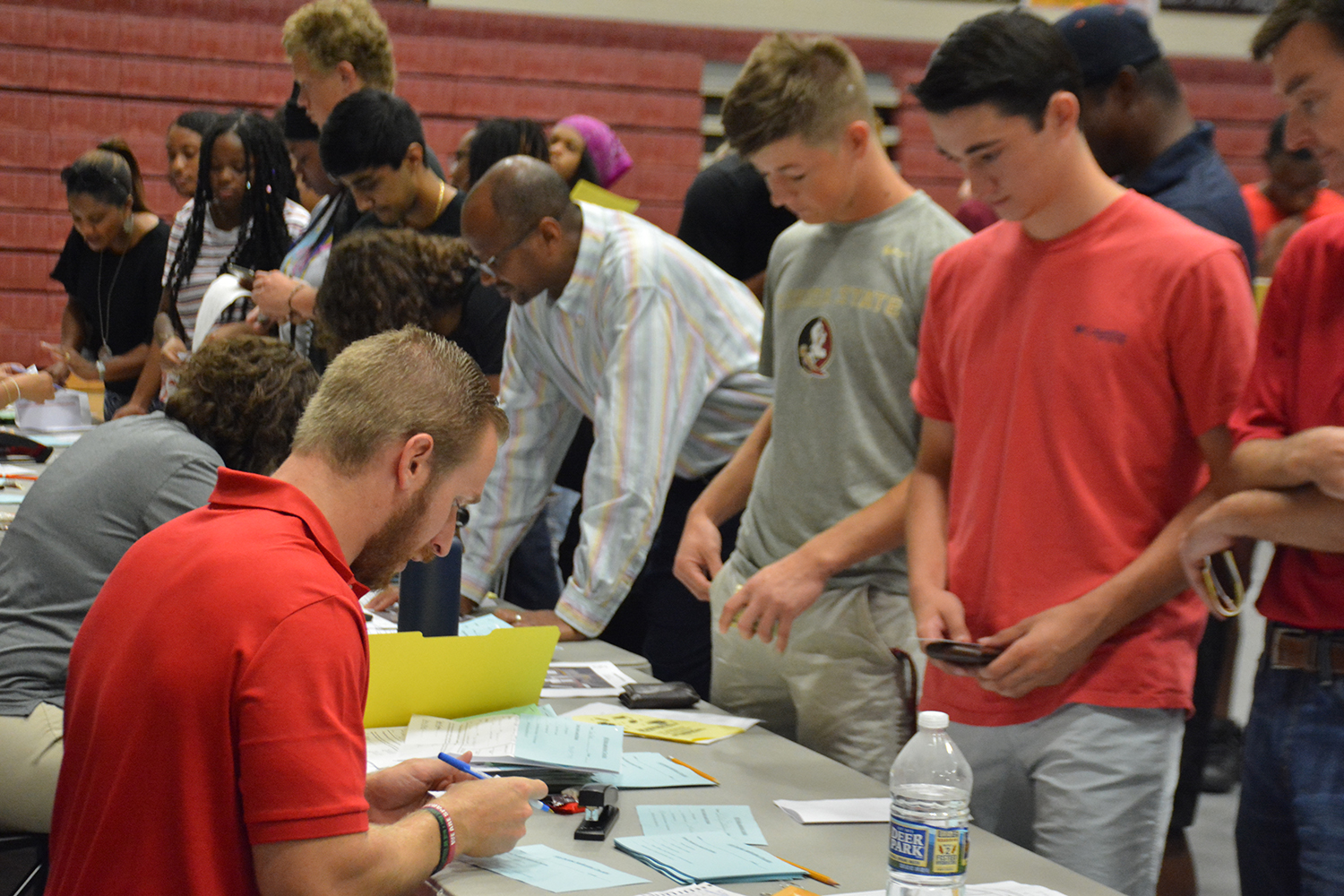 Seniors start their final year by picking up their schedules on Senator Day.