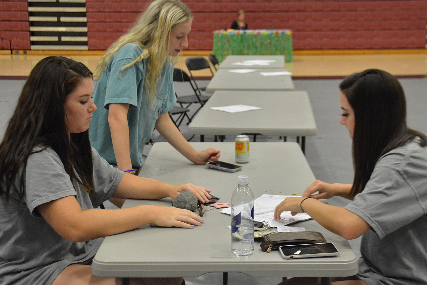 Students complete the parking application at Senator Day. Seniors were given a space while juniors were entered into a lottery to  get a parking pass for the year.