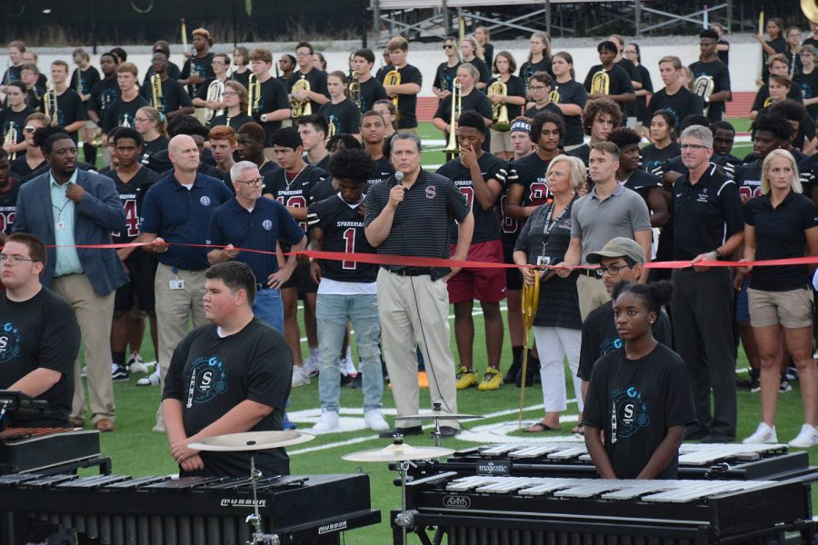 The school held a ribbon cutting ceremony for the new athletic facilities on Friday, Aug. 9. Principal Chris Shaw spoke with the crowd before cutting the ribbon.