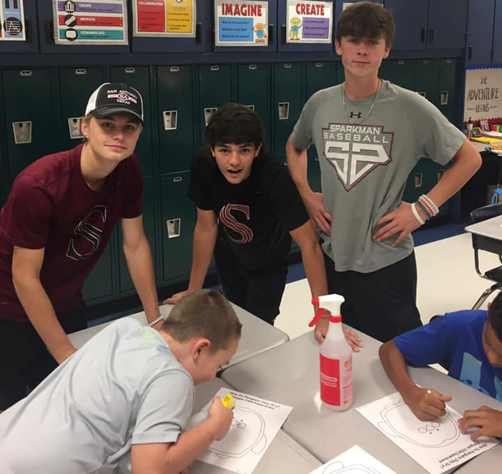 Baseball+players+Brendan+Vatz%2C+Cooper+Posey+and+Tucker+Burns+help+Legacy+students+draw+a+picture+after+reading+them+a+book.+