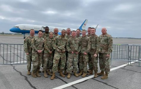 Recruiter Daniel Caldwell (fourth from the left) poses with his unit in front of Air Force One.