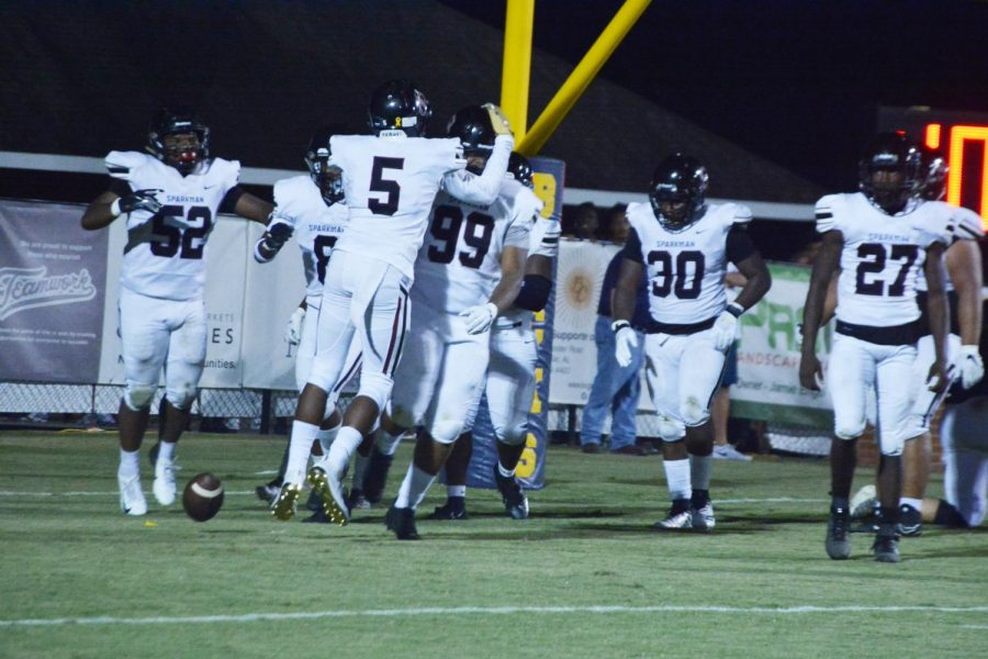 The team celebrates after a touchdown was scored against Buckhorn. The team won 38-0.