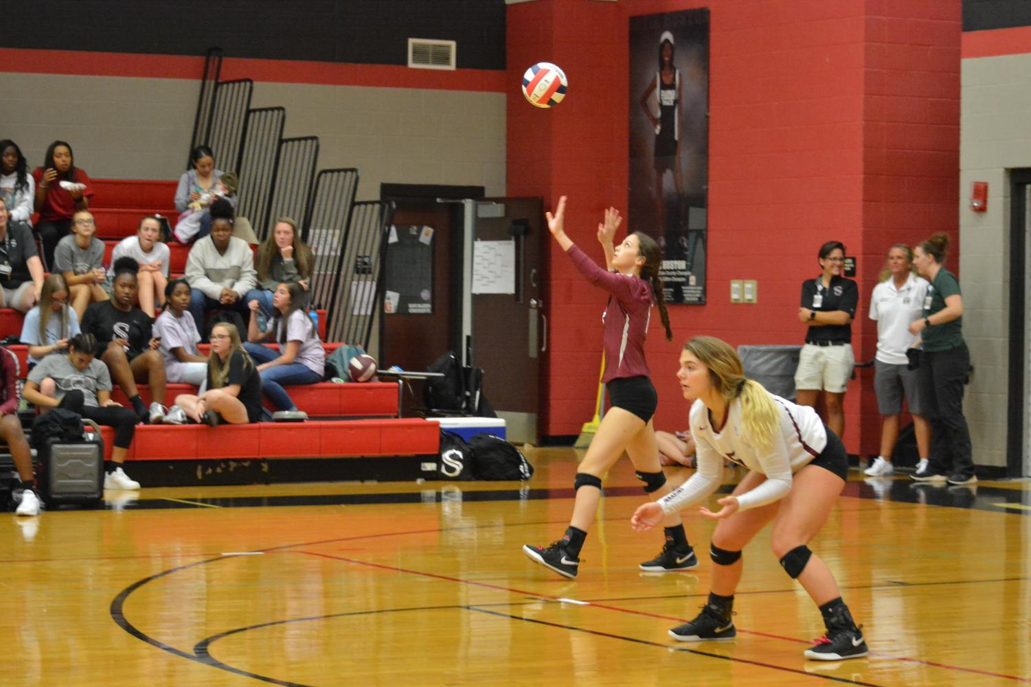 Serving the ball, junior Jessica Buford gets the match started. The team won the area title with a win over Huntsville.