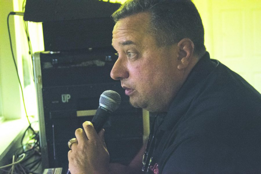 Calling out the sponsors, announcer David Owens fills up a time out. Owens calls every home football game.