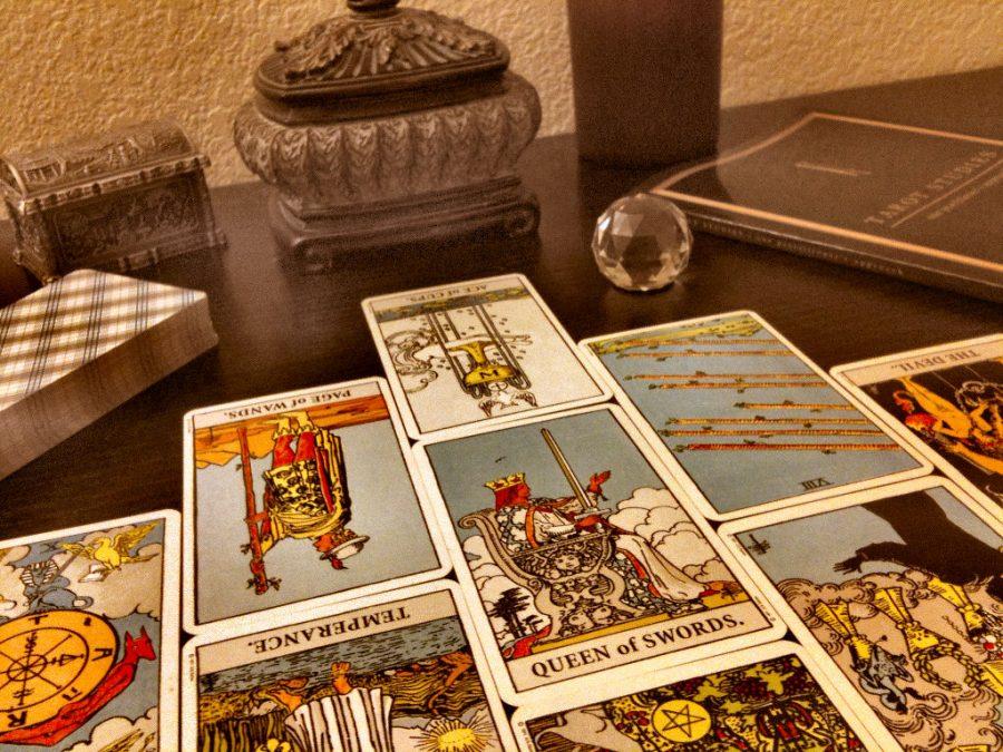 Senior+Lela+Rasmussen+studies+tarot+cards+as+a+hobby.+