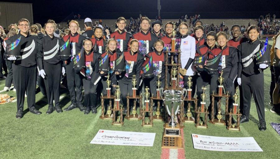 The+band+poses+with+their+array+of+trophies+after+the+Tennessee+Valley+Marching+Band+Competition.+The+band+took+home+the+Grand+Champion+trophy.+