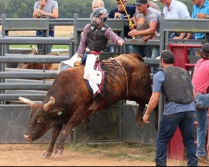As+the+chute+opens%2C+senior+James+Pitts+holds+on+to+the+bull+he+has+drawn.+Pitt+competes+all+over+the+state+of+Alabama+with+the+Alabama+High+School+Rodeo+Association.+