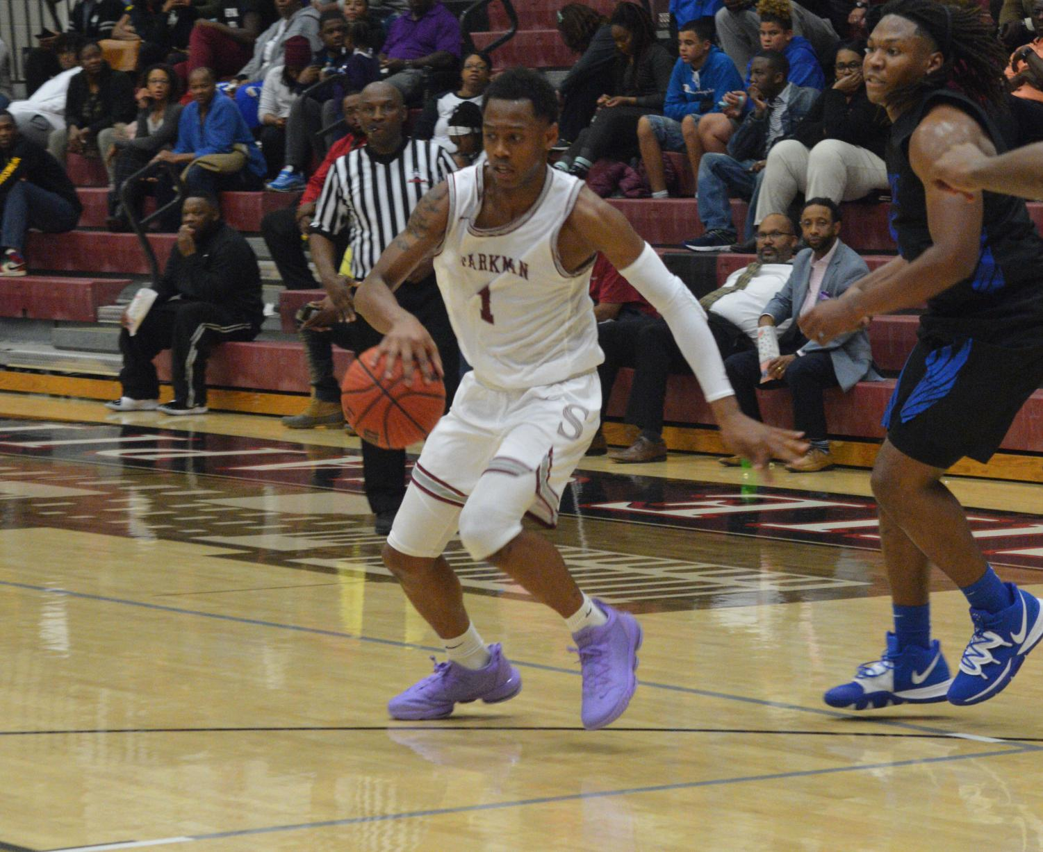 Junior Trevon Ragland dribbles past a Florence defender to get to the basket.