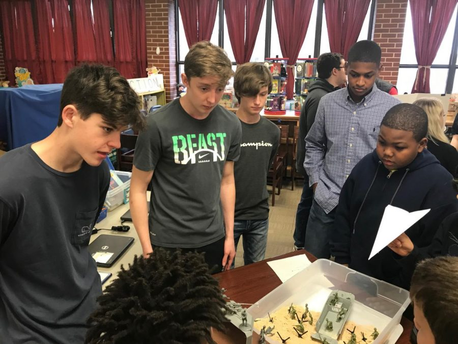 Great Wars students Ethan Cuzzort, AJ Troupe, Garrett Gonterman and Victor Dunagan discuss D-Day with a Harvest Elementary student. The boys built their own version of Utah Beach to share with the students.