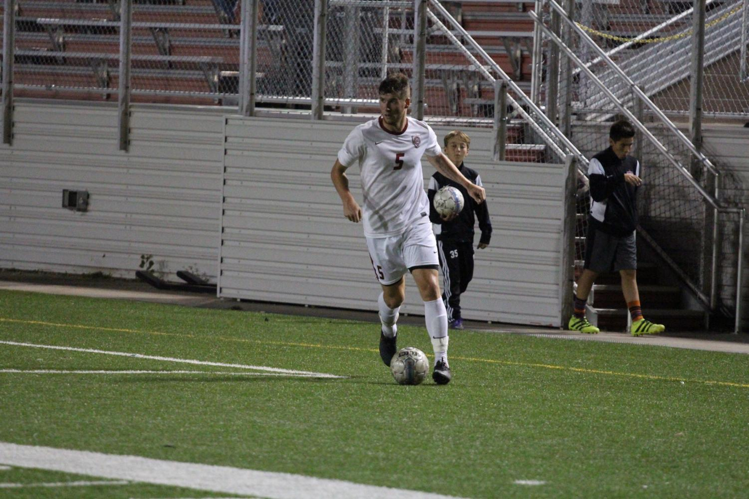 British born, Joshua Horne, plays in a game while in college. Horne will lead the boys soccer program when the practice begins in January.