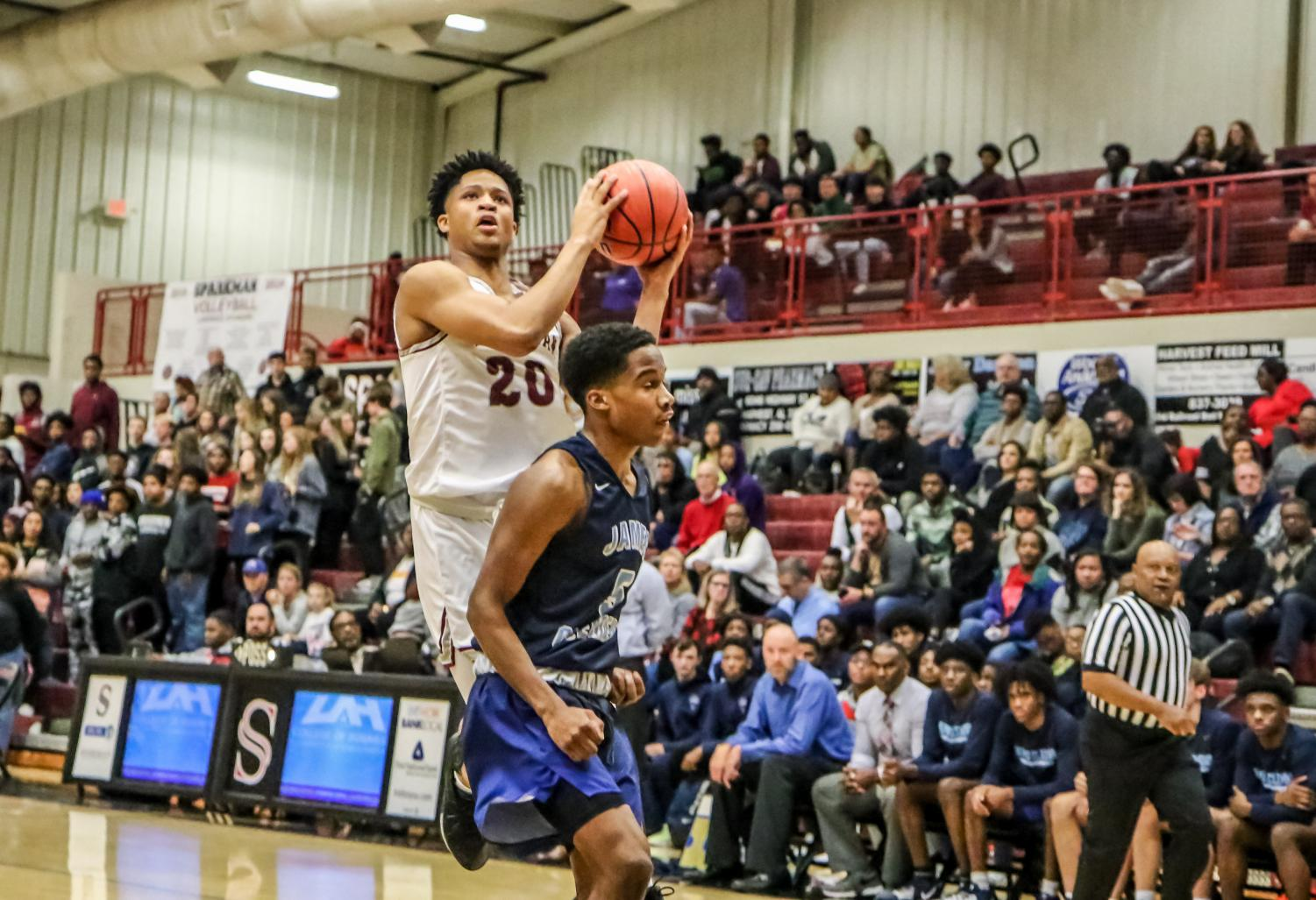 Sophomore Tyrese Elliott goes up for a lay-up against James Clemens.