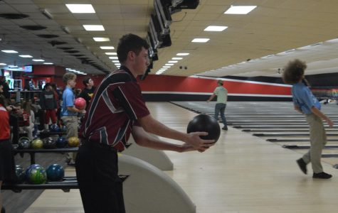 Senior Brooks Raby prepares to toss the ball down the lane. Raby played for the first time this season.