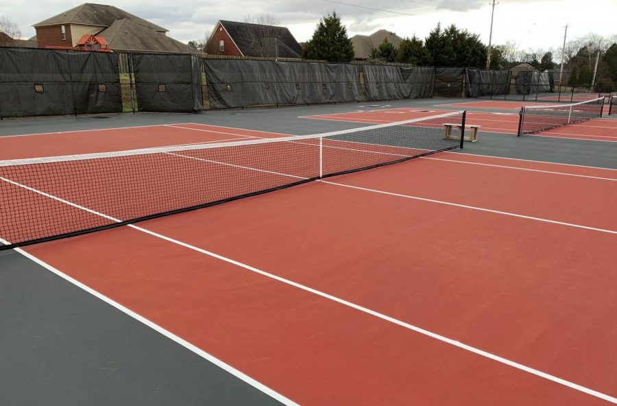 Tennis Team Begins Season On New Courts