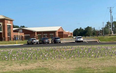 Hiles' new club remembered the anniversary of Sept. 11 with the placement of American flags.