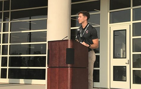 Addressing the audience at the fine arts ribbon cutting ceremony, Cody Carlton says he is happy to be on board at SHS.