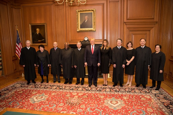 President Trump poses with Supreme Court Justices.
