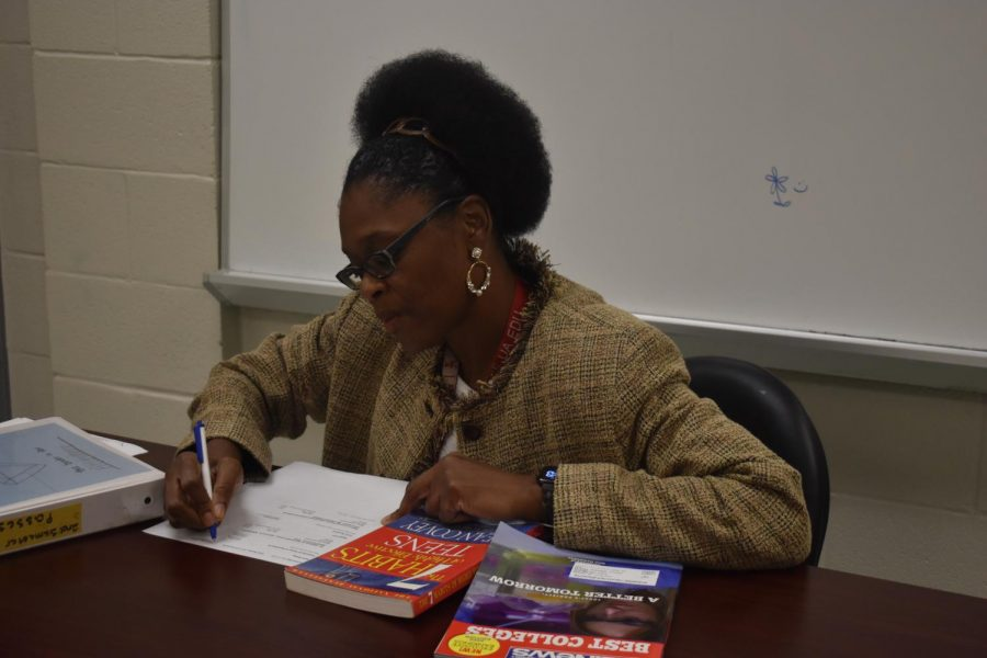 College and Career Counselor Dedra Muhammad works on recommendation letters for students.