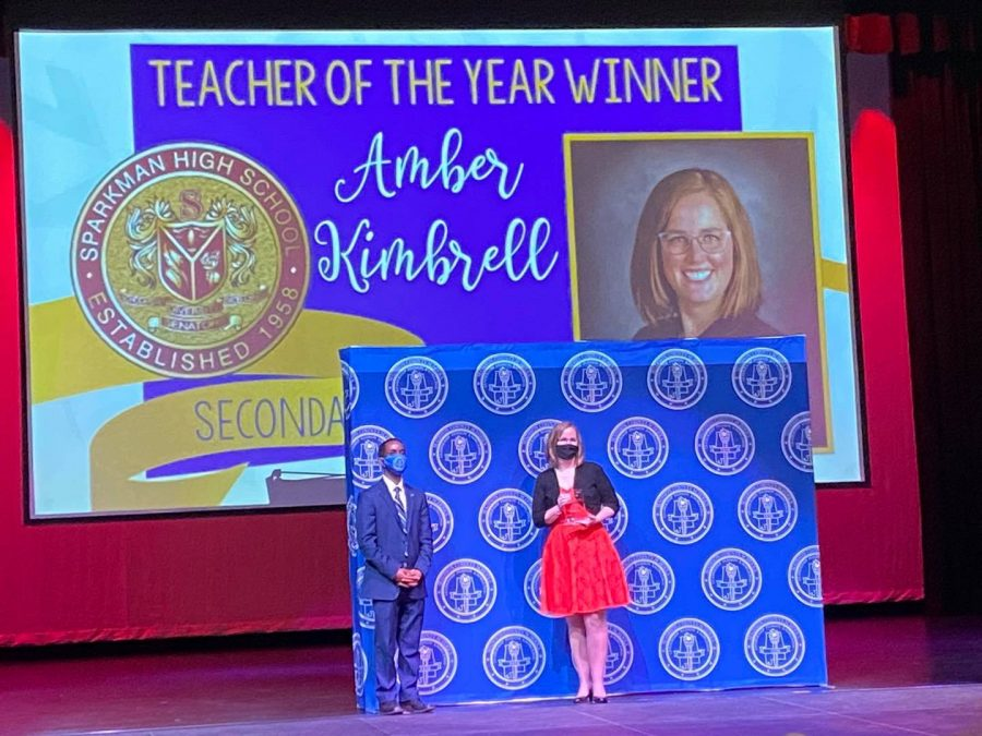 Science+teacher+Amber+Kimbrell+accepts+the+2020+Madison+County+Teacher+of+the+Year+award.+