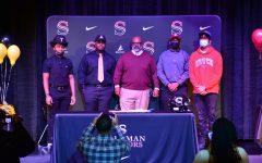 Four Senators signed college football scholarships on Wednesday, Dec. 15.