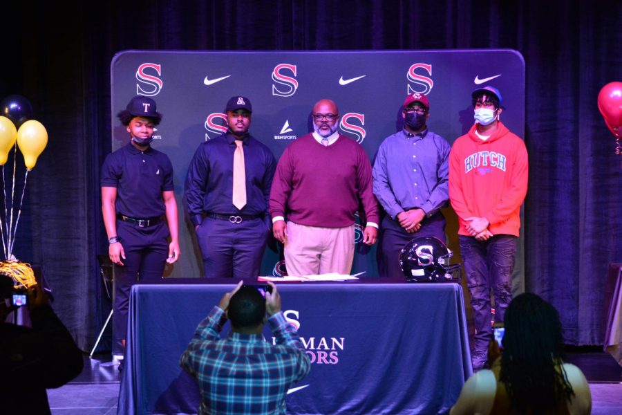 Four Senators signed college football scholarships on Wednesday, Dec. 15.
