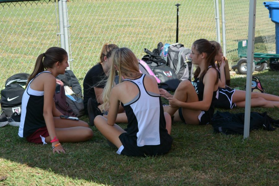 The girls cross country team take a break at the James Clemens Invitational. The team was supposed to be honored at their annual banquet in November.