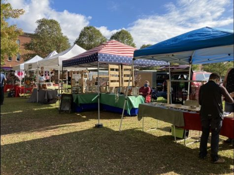 Local vendors set up tents, featuring their homemade wares.