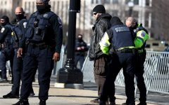 A man is being detained for questioning in Wednesday's D.C. riot.