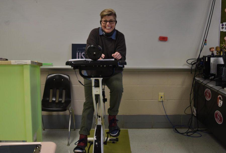 English teacher Monica Davis demonstrates how she teaches and grades from her bike.