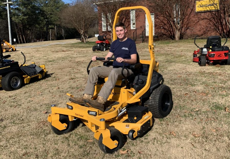 Student Mows Grass To Make Cash