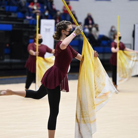 Members of the winter guard show case their routine at a recent competition.