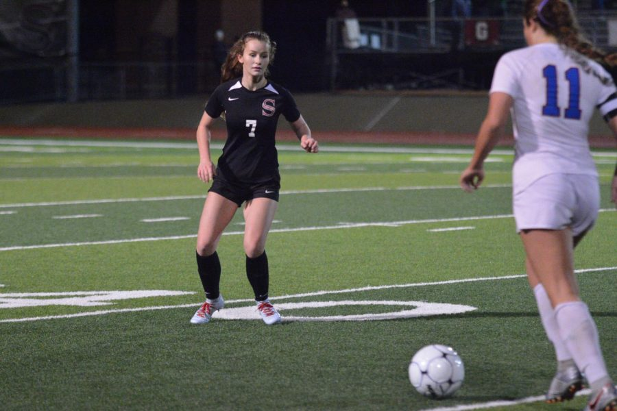 Waiting on the opponent to make her kick, junior Sammie Clegg anticipates her next move.