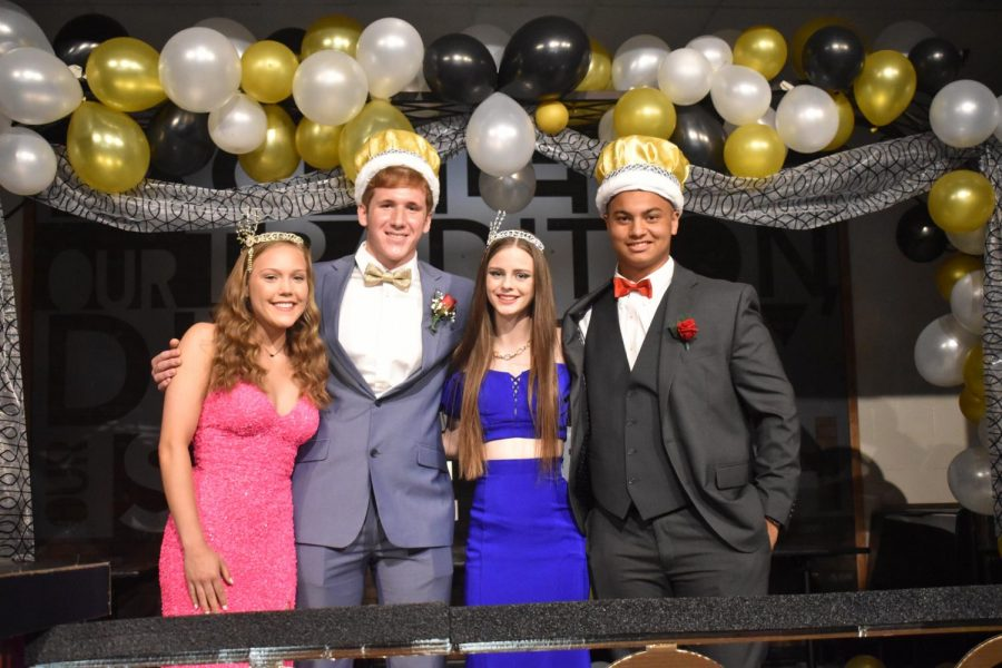 Seniors Laura Damewood, Myles Gollop and juniors Madison Allen and Jacob Edwards pose in their royal headgear.