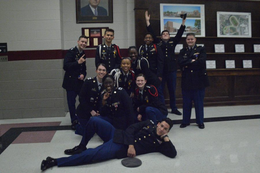 Senior Colin Romiza (top left) poses with his fellow JROTC cadets for his final senior night.