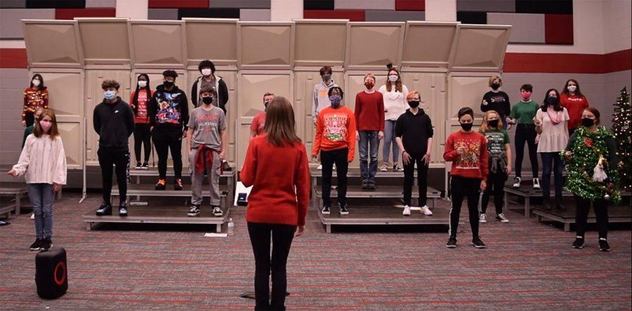 Choir teacher Caitlin Torrence leads the choir in a practice for their first concert  in December. The choir held a virtual concert then.