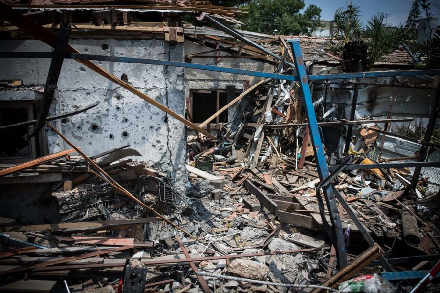 A+house+in+Israel+is+destroyed+by+an+Hamas+bomb.+