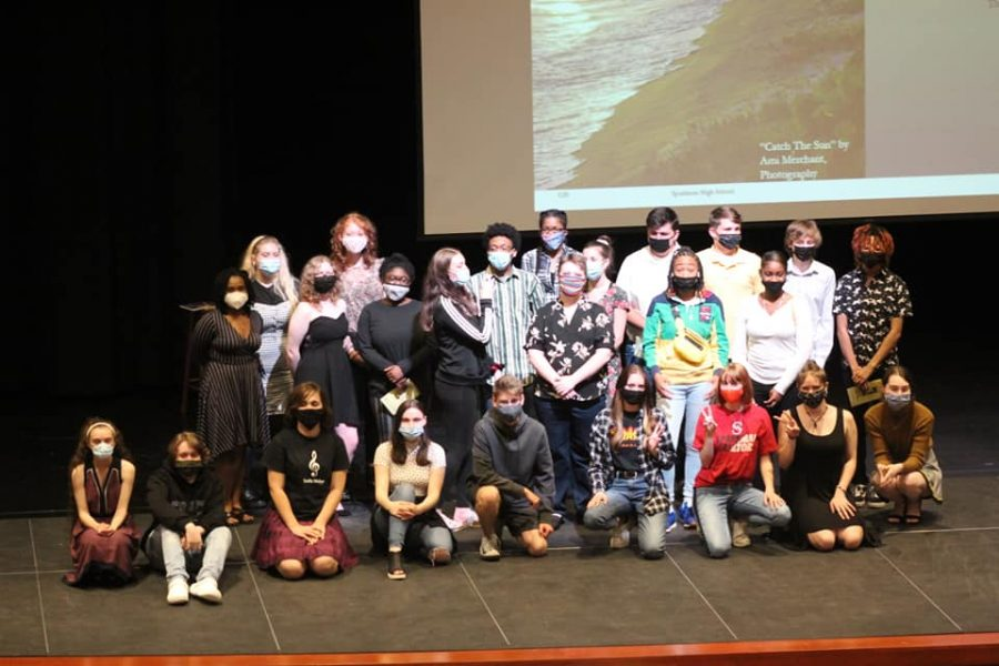The lit mag staff takes a bow after their showcase on May 25.