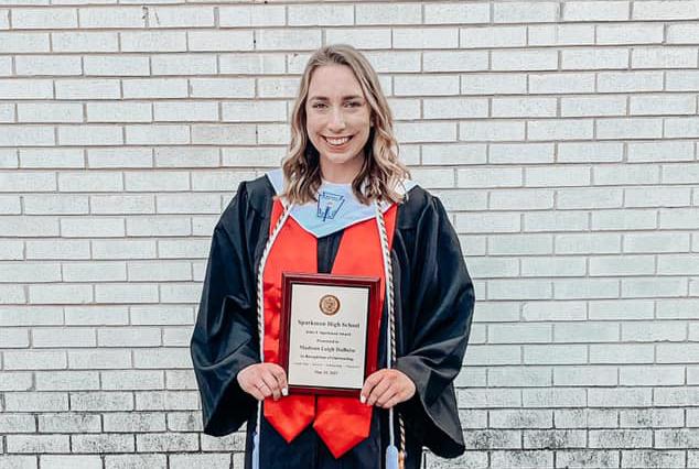 Senior Madison Duboise shows off her John J. Sparkman Award after the May 25 graduation ceremony.