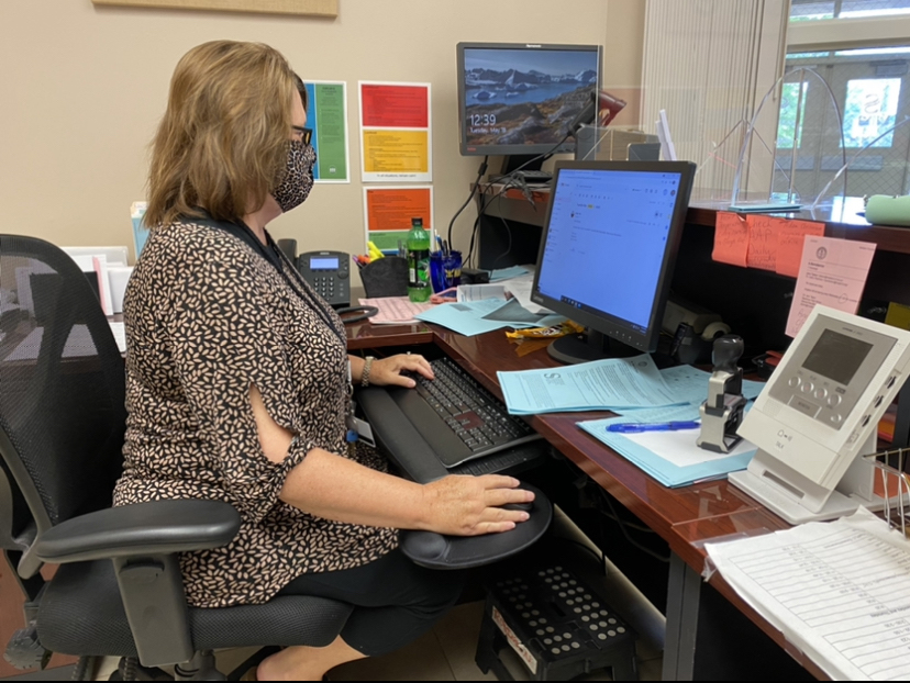 Attendance clerk Cathy Robinson catches up on check-ins for the day. Robinson turned in her retirement papers in January after 24 years in the school system.