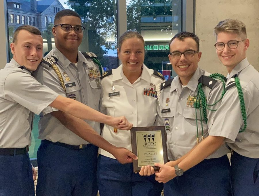 The cadet team and Sgt. Brown pose with their national award.