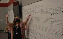 Going over the music scale with her second period class, new choir teacher Sharon Acray settles into her new position.