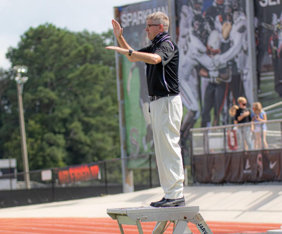 Band director, David Raney, directs the band during practice.