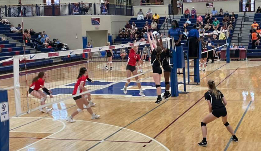 The volleyball team faces off against Hazel Green in the first match of the Iron Man Tournament.