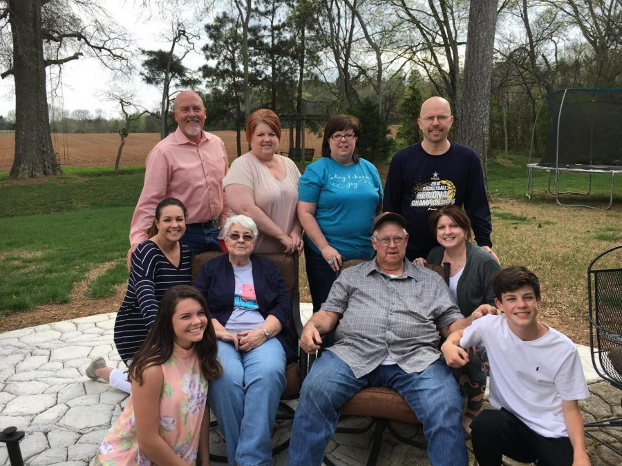 Journalism teacher Erin Coggins and her family pose for one of the last family events the Cartee family held with their Dad.