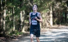 Sophomore Wyatt Harris nears the end of the first cross country race of the season.